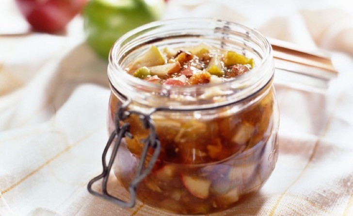 Apples preserved in open mason jar.